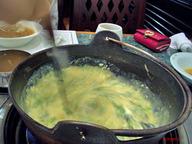 Stir_porridge_seaweed